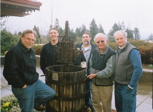 Terry Casteel and friends admire the press he used to make his first Steamboat pinot noir (now a garden decoration)