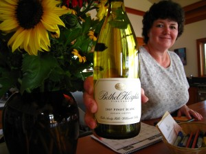 Kate in the tasting room with her amazing sunflowers and 2007 Pinot blanc